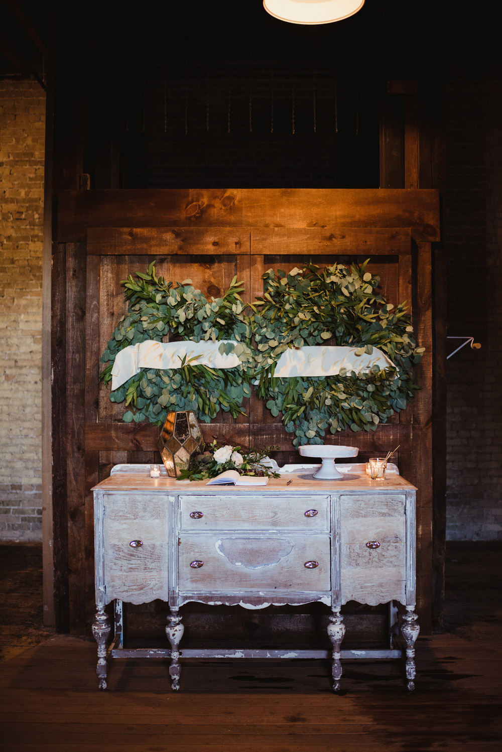 A La Crate Rentals at The Lageret White Wash Buffet Welcome Table Rental Stoughton Wisconsin Vintage Wedding Rentals