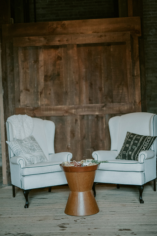 Vignette set up for guests at The Lageret in Stoughton Wisconsin. Corporate Holiday Party Photo Shoot. ALaCrateRentals-TimFitch-Alexis-Mike-Wedding-361-Wood-Arbor-The-Lageret - Vintage Industrial Rentals