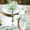Lake Geneva, Wisconsin head table featuring brass vase rentals.