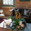 Emilia Jane Photography of lounge area set-up for 65th birthday party celebration in Chicago, IL using our chesterfield sofa and coffee table rentals