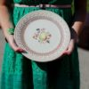 Mis-matched vintage dinner plates for outdoor park wedding in Madison, Wisconsin.