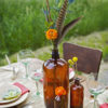 Boho styled photo shoot using amber glass as centepieces.