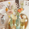Vintage vanity mirror as reception centerpiece.