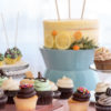 Variety of cake stands paired with To Di For bakery on A La Crate Rentals trays.