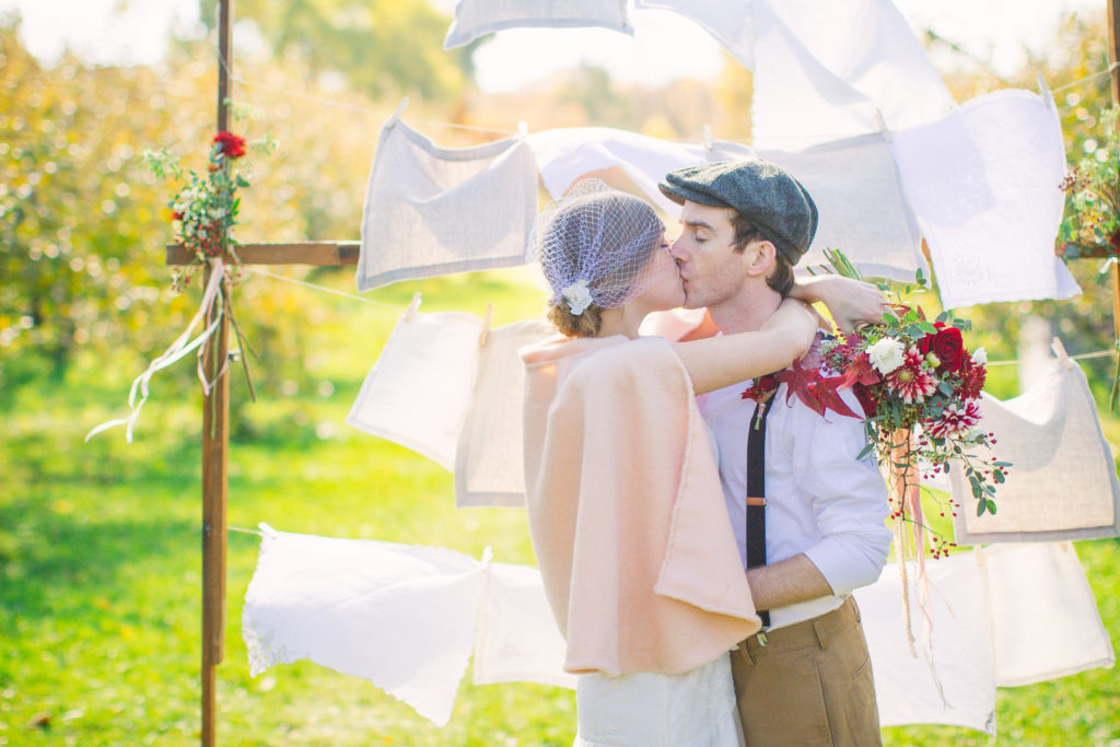 Outdoor Wedding Ceremony using Quilt Rack Rental Backdrop from A La Crate Rentals. Madison, Wisconsin