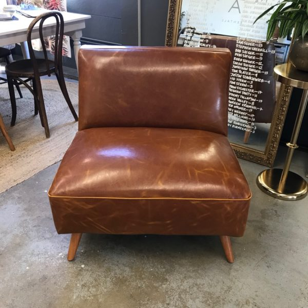 Cognac leather chair for corporate lounge.
