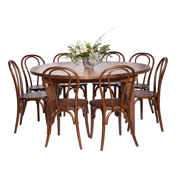Solid reclaimed round wood table rental